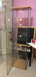 Glass tall cupboard with light