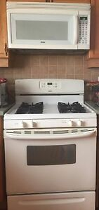 Kenmore Gas range and Microwave.