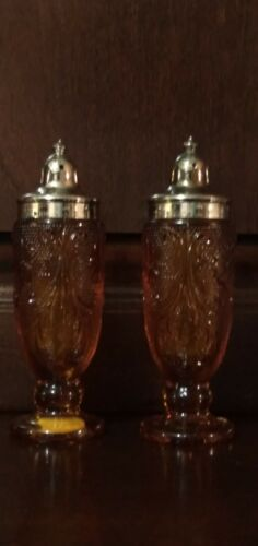 A tiara exclusive amber tone glass salt and pepper shakers
