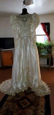 VTG. ? DEMETRIOS WEDDING DRESS,BEAUTIFUL LONG TRAIN . NNT.  SZ 8.  LOW BACK CUT