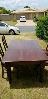 Antique timber dining table & 4 chairs with leather seats.