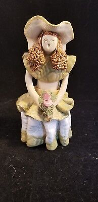 Clay Sculpted pottery Figurine girl w/flowers