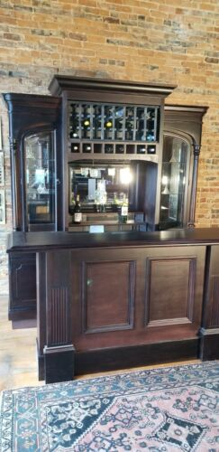 arched door bevelglass front and back wine bar