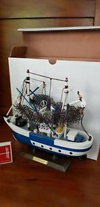 Assembled model timber fishing boat on stand - toy or collectable