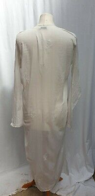 Juliet Dunn woman's long kaftan dress. White with embroidery