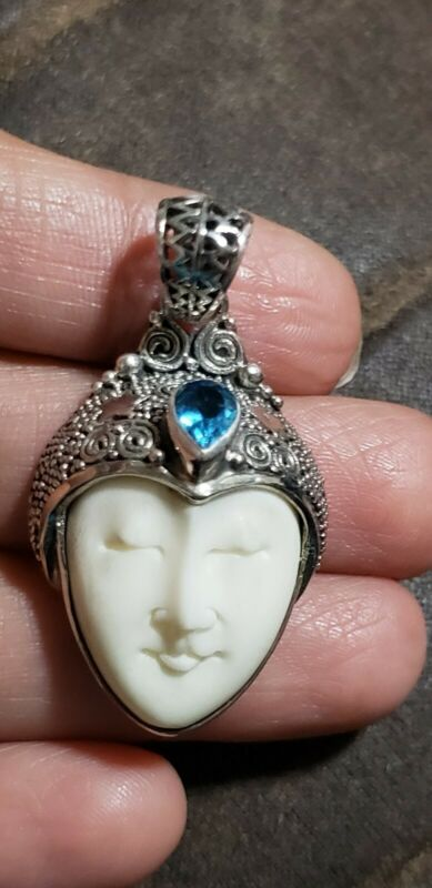 Bali Goddess collection carved Bone blue topaz sterling silver pendant