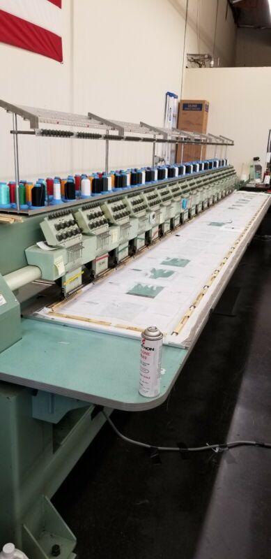 Tajima TMEG-VG918 - Commercial 18 Head Embroidery Machine - USED