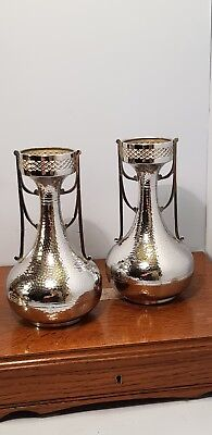 ART NOUVEAU STYLE SILVER METAL VASES WITH HAMMER EFFECT FINISH.