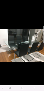 glass dining table with black and white square legs