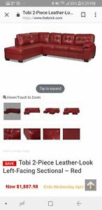 Two-piece red leather-look left facing sectional