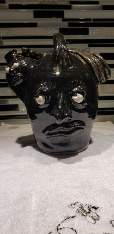 Face jug folk art pottery