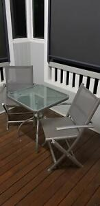 Outdoor dining set glass top table and 2 folding chairs