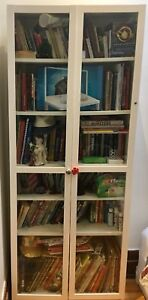 Tall glass-fronted bookcases, $60 each/$100 for the pair