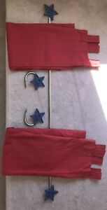 Star curtain rods with matching red curtains