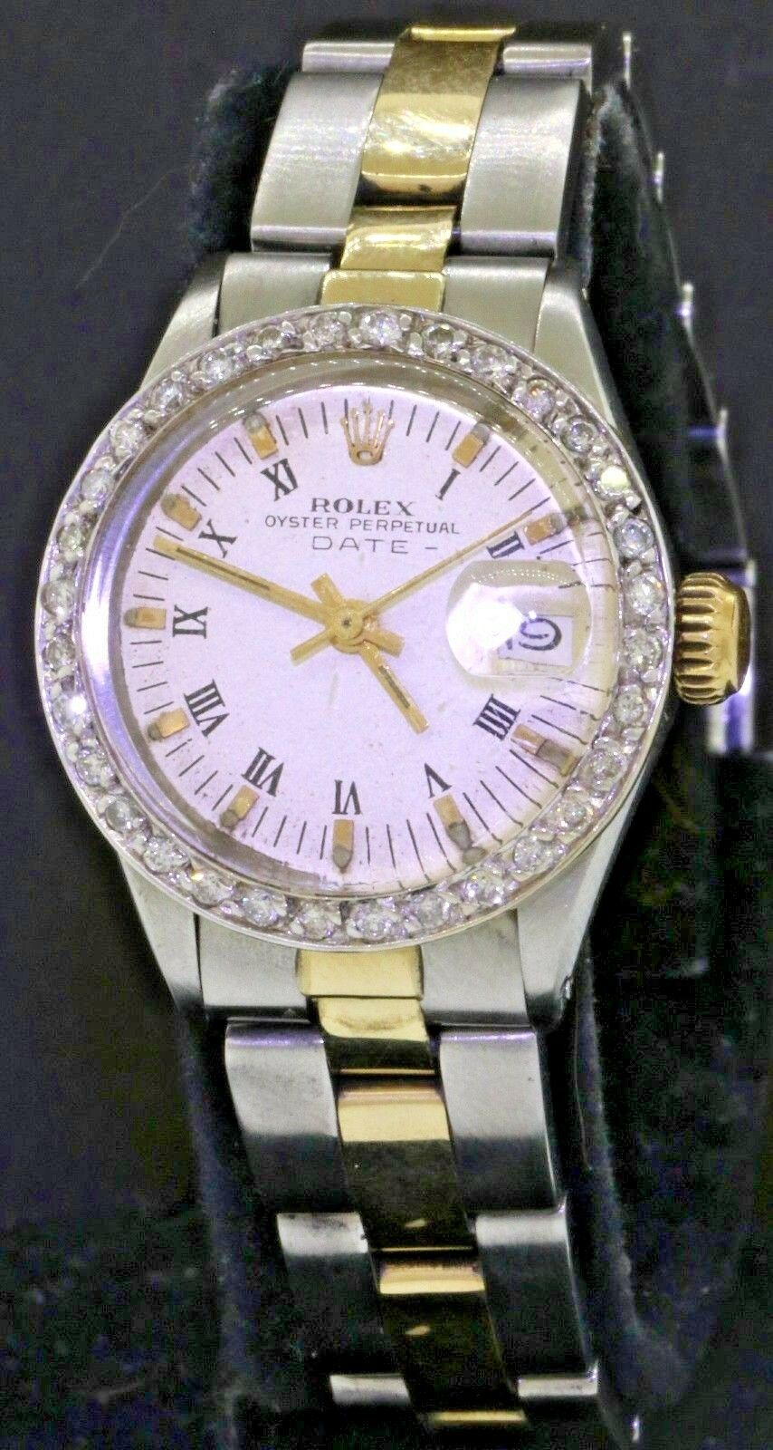 $1625.00 - Rolex Date 6517 elegant SS/14K gold automatic lady's watch w/ diamond bezel