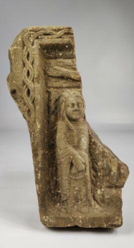 A Medieval Romanesque Limestone Fragment.