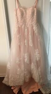 Sweetheart neckline in blush/ivory colour  wedding dress .