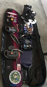 Two snow boards with set of boots and carry case