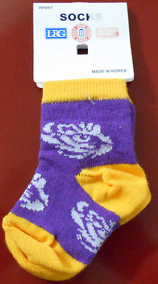 - LOT OF 1 NEW INFANT LSU SOCKS 0-3MO'S & 1 NEW SET 0F 2 LSU PACIFIERS.