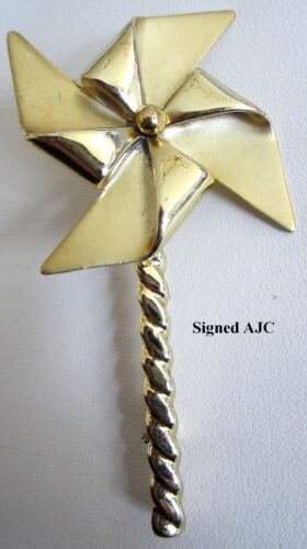 Vintage AJC Movable Twirling Pinwheel Brooch Pin Gold Tone