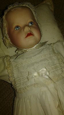 VINTAGE ANTIQUE BEAUTIFUL PORCELAIN  BABY DOLL WITH SILVER RATTLE AND PILLOW