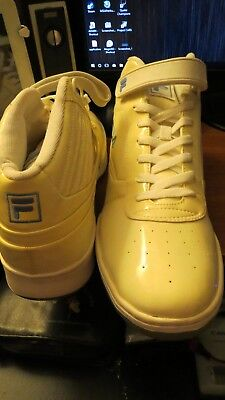 (Men's NEW Fila fw00550-165 White patent leather Sneakers size 13)