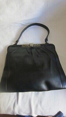 1940s Handbags and Purses History 1940,s black lge leather handbag with fab deco frame. $24.50 AT vintagedancer.com