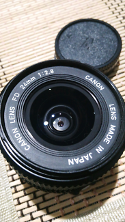 Canon FD (nFD) 24mm 1:2.8 with UV filter and caps