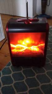 RED PORTABLE HEATER WITH FLAME EFFECT Paddington Brisbane North West Preview