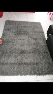 Large grey shag rug