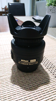 Nikon 35mm F1:1.8G with UV filter and caps