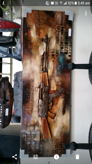 Wanted: Wanted  metal artwork of a AK47