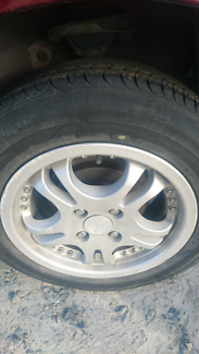 """MAZDA 323 FORD LASER 14"""" ALLOY WHEELS NEW TYRES"""