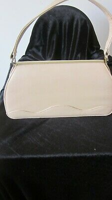 1950s Handbags, Purses, and Evening Bag Styles 1950,s ORLOS beige leather handbag with interesting clasp. $29.96 AT vintagedancer.com