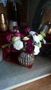 Beautiful gold vase vase with colourful flower arrangement