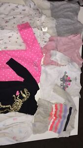 Baby girl clothes ranging from 6-12 months.