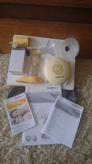 Medela Swing Breast Pump + Valves & Membranes set + Breast Pads