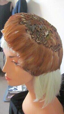 1950s Hats: Pillbox, Fascinator, Wedding, Sun Hats 1950,s fab orig vint feathered caplet in rust/cream multi colours.Lovely hat! $51.72 AT vintagedancer.com