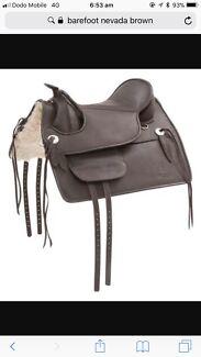 Fully mounted barefoot Nevada saddle