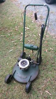 Antique champion lawn mower, old lawn mower, push mower
