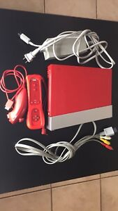 Red Nintendo Wii Console with Super Mario Bros Video Game