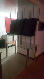 Glass dinning table & 6 chairs