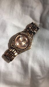 Rose gold guess watch