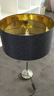 Silver/chrome lamp with black and gold shade