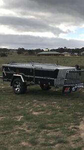 MDC rear fold hard floor camper