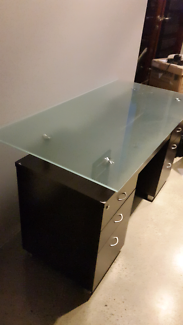 Desk with glass top and keyboard draw ..
