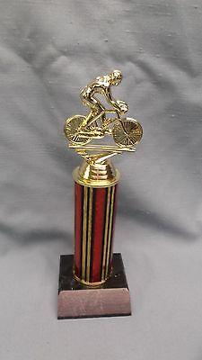 road bike trophy red column black wood base female rider