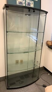 Italian curved front glass display case with light