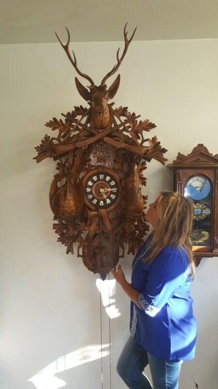 Beautifully carved 5 ft  antique cuckoo clock