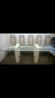 Lovely Bevelled Glass Dining table with six matching chairs.
